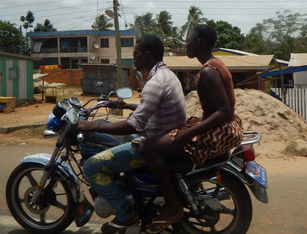 Man and woman riding the moto near the Volta Region.